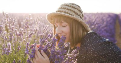 A woman smelling lavender