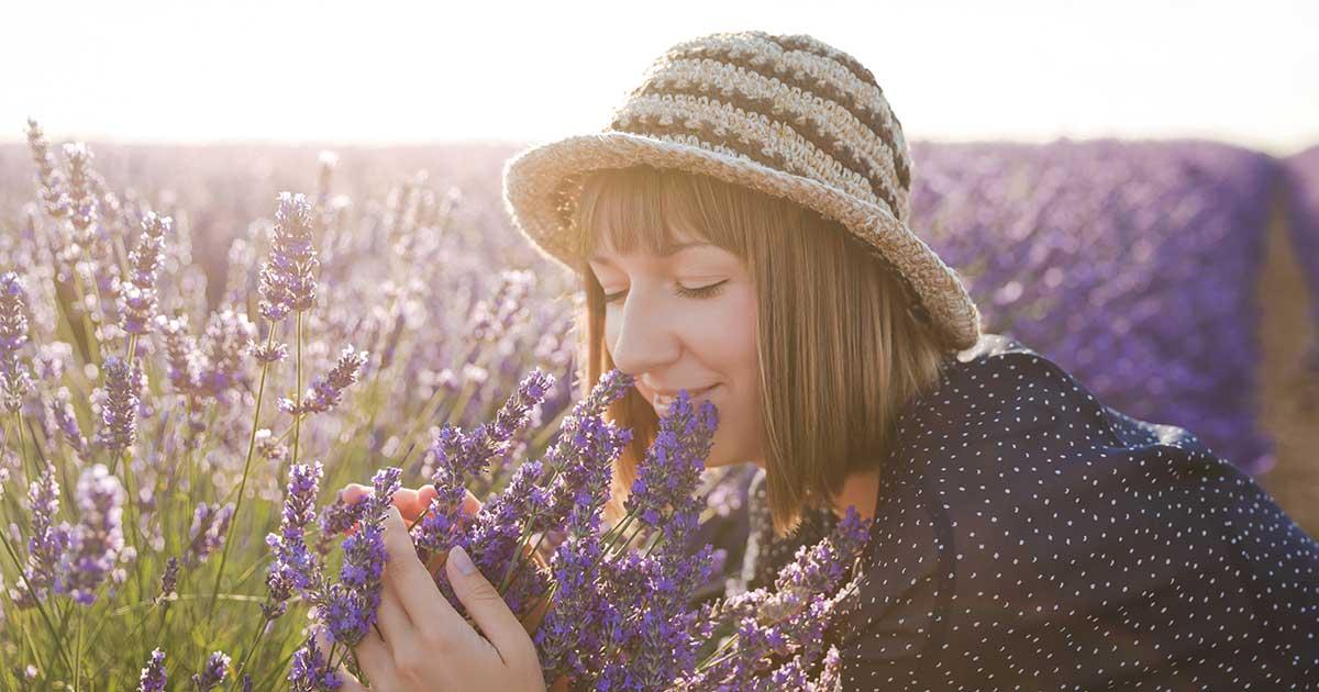 A woman smelling lavender